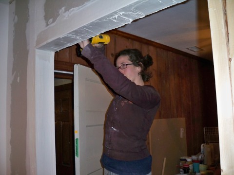 Miriam has become an expert at doing drywall