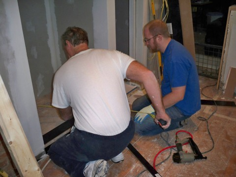 Brian and I installing hardwood floors in the pantry and fridge alcove